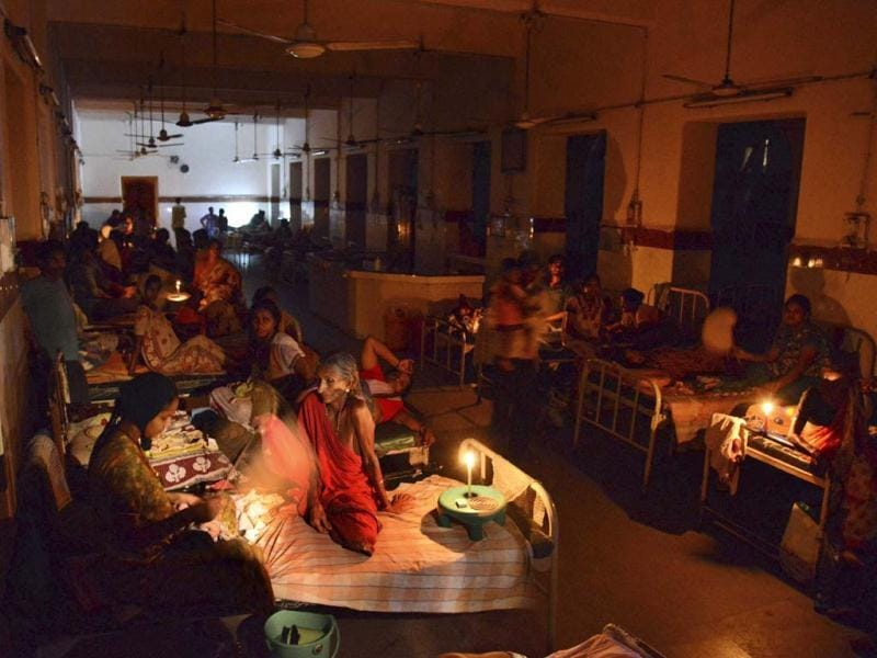Patients light candles and use hand fans to beat humidity at the King George hospital during a power outage at Visakhapatnam.(AP Photo)