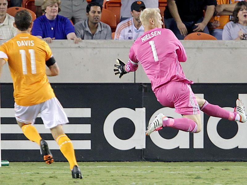 Houston Dynamo goalkeeper Jimmy Nielsen goes after the ball during the first half of MLS soccer game action against Sporting Kansas City at BBVA Compass Stadium in Houston. (AP Photo/Houston Chronicle)