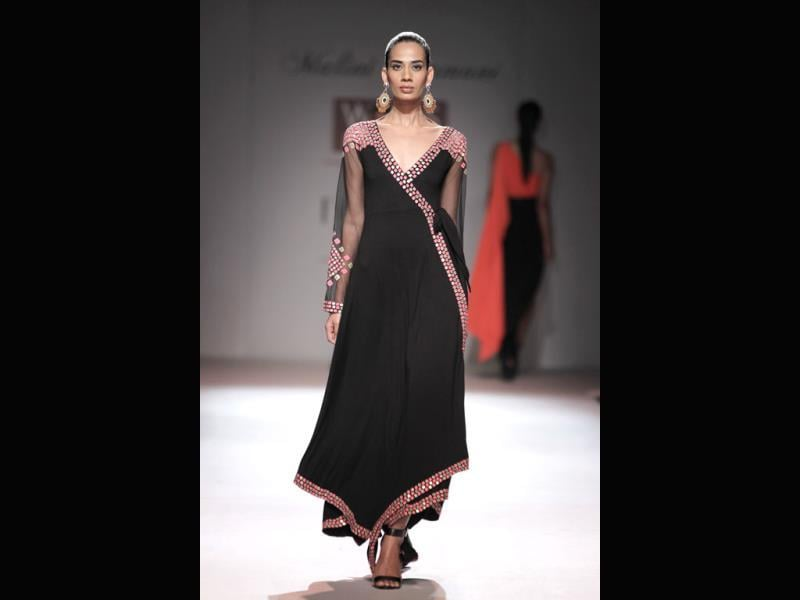 A black kaftaan dress by Malini Ramani.
