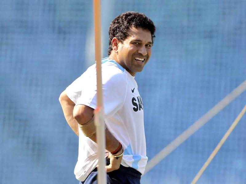 Sachin Tendulkar smiles during a training session ahead of their third test cricket match against West Indies in Mumbai in 2011. (AP Photo)