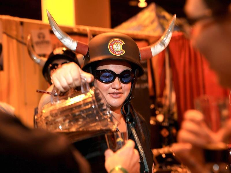 Sarah Rickert pours beer for Bull & Bush Brewery during the 32nd annual Great American Beer Festival at the Colorado Convention Center in Denver, Colorado. (AFP Photo)
