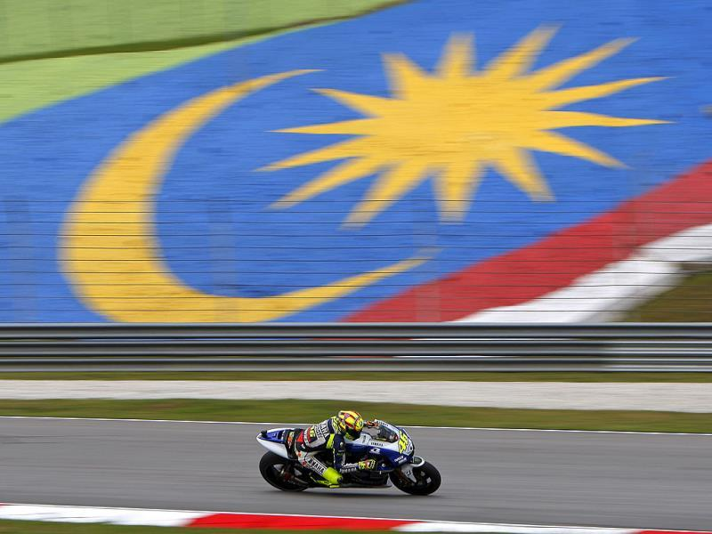 MotoGP rider Valentino Rossi of Italy steers his Yamaha during the first free practice session for Malaysian Motorcycle Grand Prix in Sepang, Malaysia. (AP Photo)
