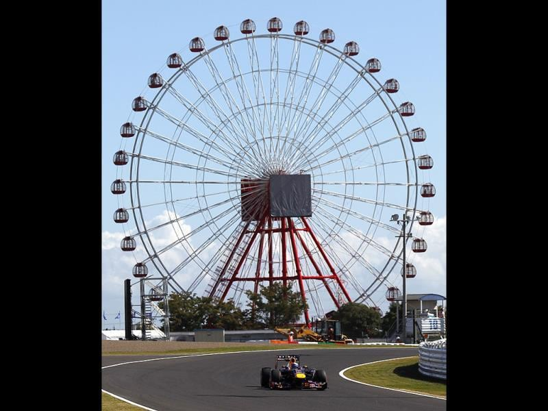 Red Bull driver Sebastian Vettel of Germany steers his car with a backdrop of a ferris during the first practice session for the Japanese Formula One Grand Prix at the Suzuka Circuit in Japan.(AP Photo)