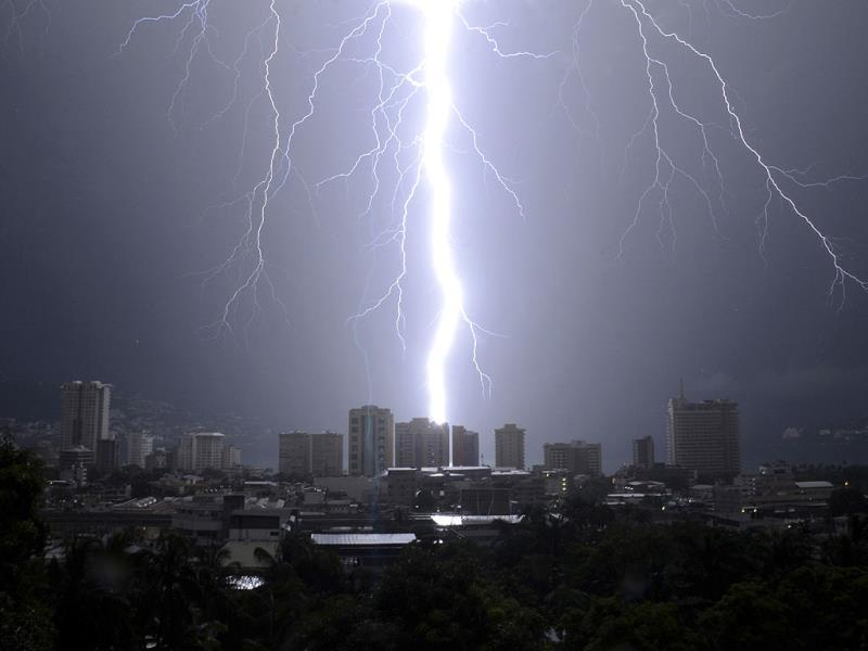 A bolt of lightning strikes down over Acapulco, Mexico. (AP Photo)