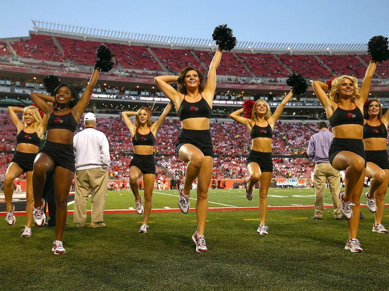 Members of the Louisville Cardinals dance team perform before the game against the Rutgers Scarlet Knights at Papa John's Cardinal Stadium in Louisville, Kentucky. (AFP Photo)