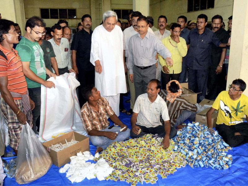 Odisha CM Naveen Patnaik inspects the packaging of relief material for the cyclone in Bhubaneswar. (PTI photo)