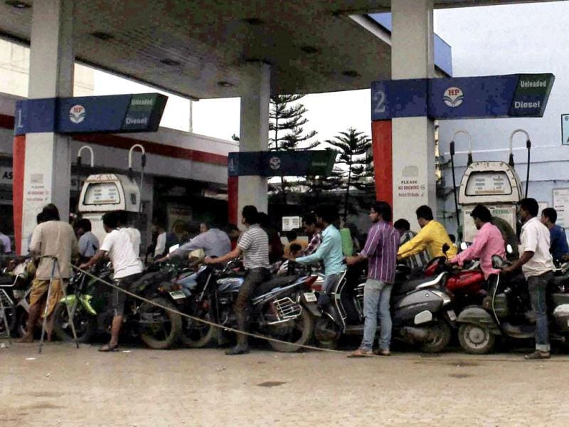 People queue up to fill petrol at a petrol pump in Berhampur in fear of cyclone on Friday. (PTI photo)
