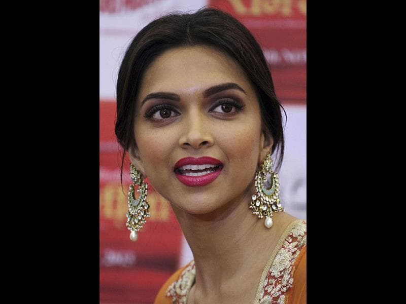 "In this Wednesday, Oct. 9, 2013 photo, Deepika Padukone answers to a question during a press conference held to promote her new Hindi film ""Ramleela"" in Ahmadabad, India. The film will be released on Nov. 15. (AP Photo)"