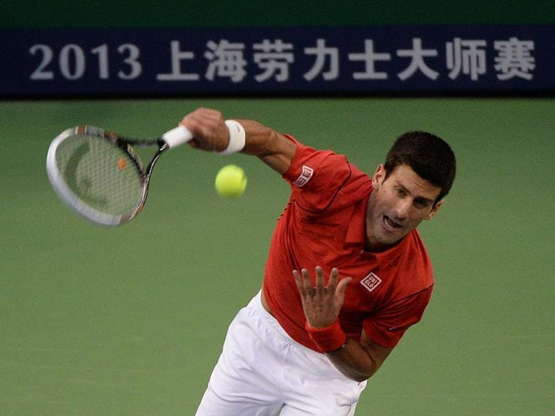 Novak Djokovic of Serbia serves against opponent Jo-Wilfried Tsonga of France during their men's singles semi-finals at the Shanghai Masters 1000 tennis tournament held in the Qizhong Tennis Stadium in Shanghai. (AFP Photo)