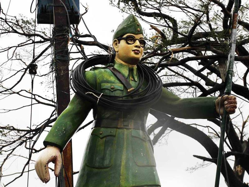 Electric wires entangled around the statue of Subhash Chandra Bose at road crossing post Cyclone Phailin in Berhampur. (AP Photo)