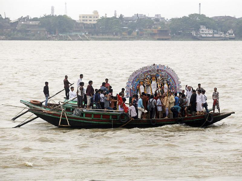 An idol of goddess Durga is transported on a boat for immersion in the waters of river Ganges on the last day of the Durga Puja festival in Kolkata. REUTERS