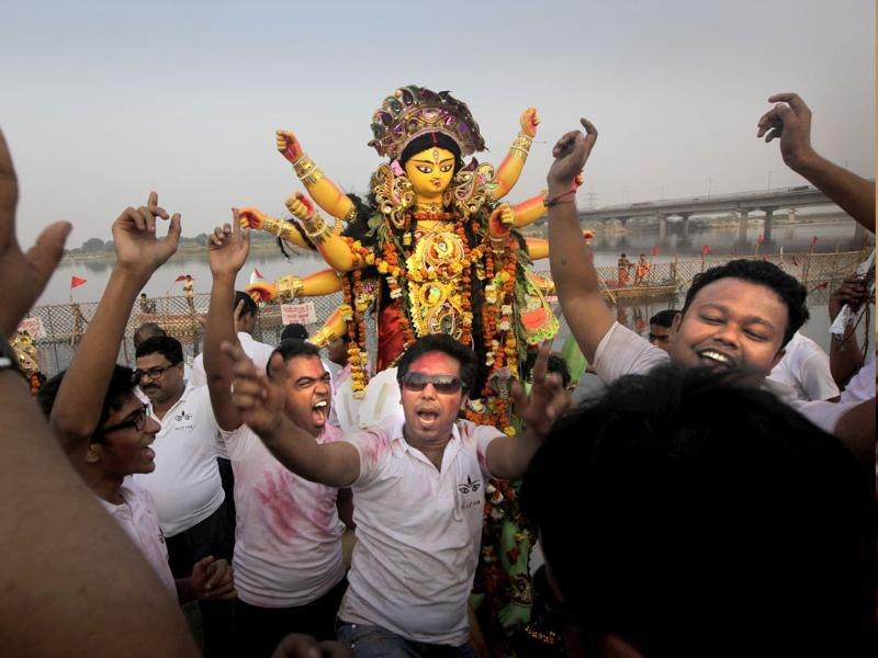 Hindu devotees dance before immersing an idol of Hindu goddess Durga in the river Yamuna at the end of the Durga Puja festival, in New Delhi. AP Photo