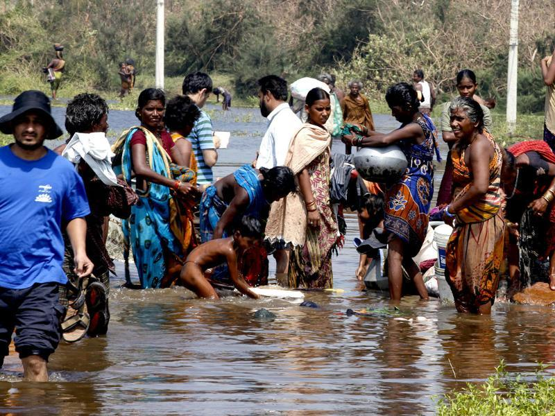 Balugaon Villagers in knee deep water as they pump out water from their home in Kaurd district in Odhisa, after Cyclone Phailin struck. (Raj K Raj/HT)