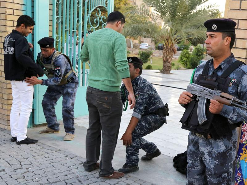 Security forces search worshipers outside a mosque on the first day of Eid al-Adha in Baghdad. (AP photo)