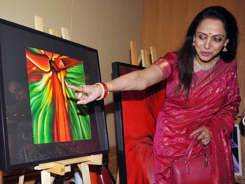 Bollywood actress Hema Malini poses for a photo during the inauguration of the art and couture exhibition Sarvam-Shashvatam in Mumbai on October 14, the eve of her 65th birth anniversary. Browse through a pictorial journey of her Bollywood life .(AFP Photo)