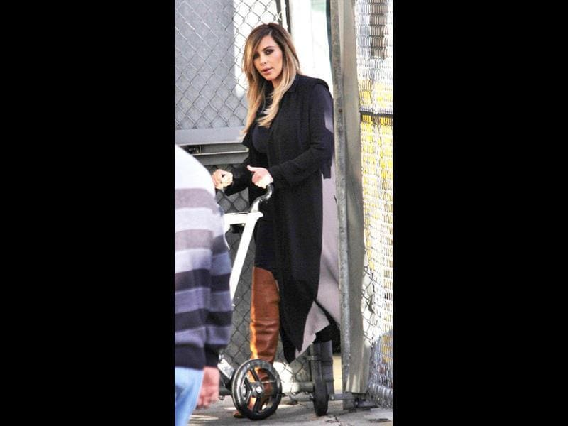 Kim takes her baby North West on a stroller outing.