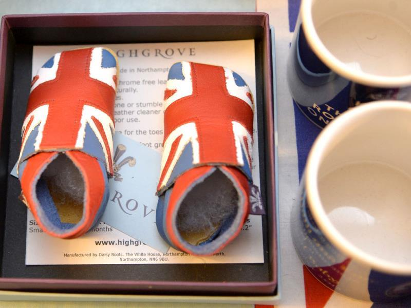 A pair of union flag covered baby boots, to celebrate the birth of Prince George, seen at the house of Margaret Tyler who has dedicated her house as a shrine to the family. (Reuters Photo)