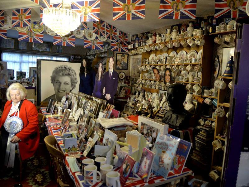Margaret Tyler sits with royal paraphernalia at her house, which she has dedicated as a shrine to the British royal family. (Reuters Photo)