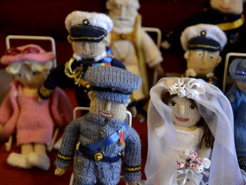 Commemorative puppets representing the wedding of the Britain's Prince William and his wife Catherine, seen at Margaret Tyler's house. (Reuters Photo)