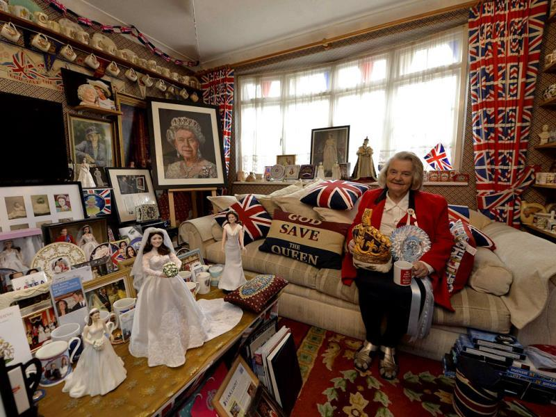Margaret Tyler sits in the front room of her house, which she has dedicated as a shrine to the British royal family. (Reuters Photo)