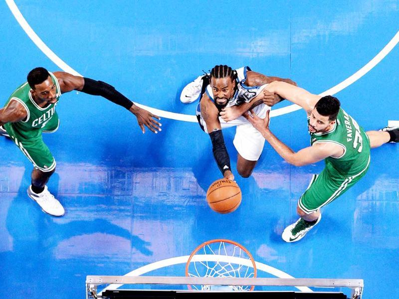 Minnesota Timberwolves center Ronny Turiaf battles for a rebound with Boston Celtics forward Jeff Green and teammate Vitor Faverani during the third quarter at the Bell Centre. (Eric Bolte-USA TODAY Sports)