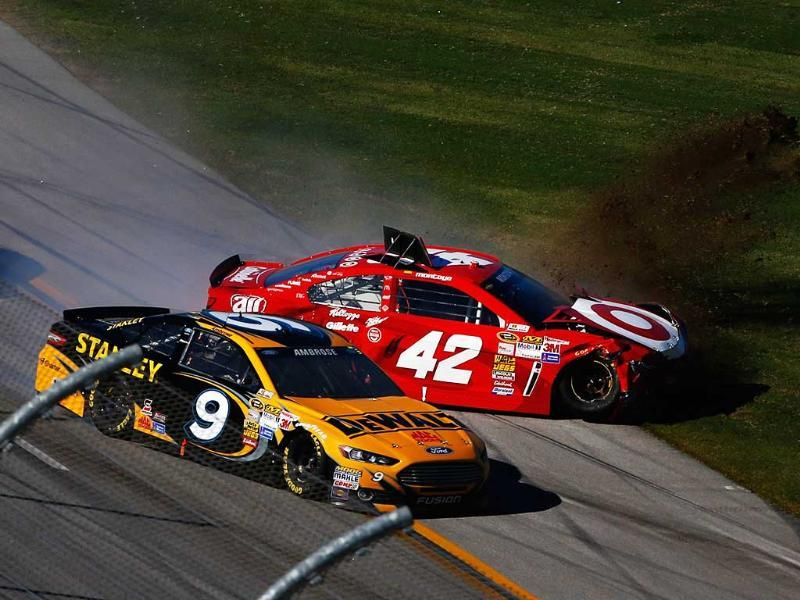 Marcos Ambrose, driver of the #9 DeWalt Ford, and Juan Pablo Montoya, driver of the #42 Target Chevrolet, are involved in an incident during the NASCAR Sprint Cup Series Camping World RV Sales 500 in Talladega, Alabama. (AFP Photo)