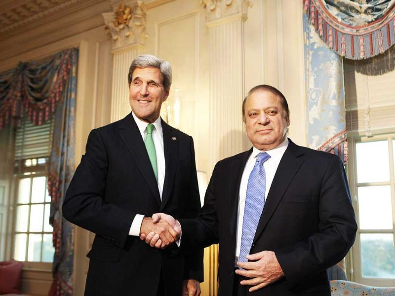 US secretary of state John Kerry shakes hands with Pakistan's Prime Minister Nawaz Sharif before their meeting at the State Department in Washington. (Reuters Photo)