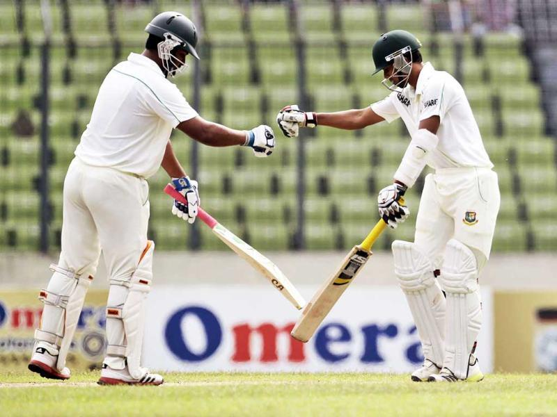 Bangladesh's Tamim Iqbal and Marshall Ayub touch gloves each other on the first day of the second cricket test match against New Zealand in Dhaka, Bangladesh. (AP Photo)
