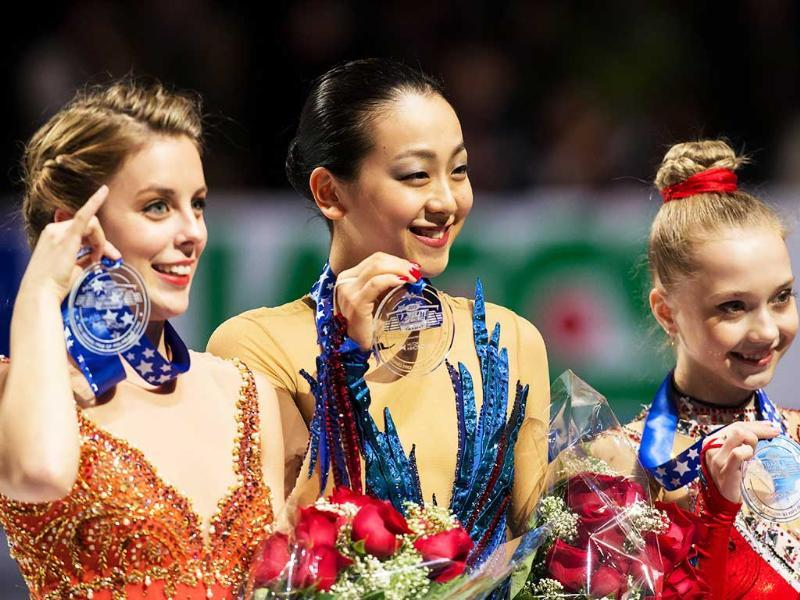 Gold medalist Mao Asada of Japan, silver medalist Ashley Wagner of the US and bronze medalist Elena Radionova of Russia pose with their medals during the women's medal ceremony at Skate America 2013 in Detroit, Michigan. (AFP Photo)