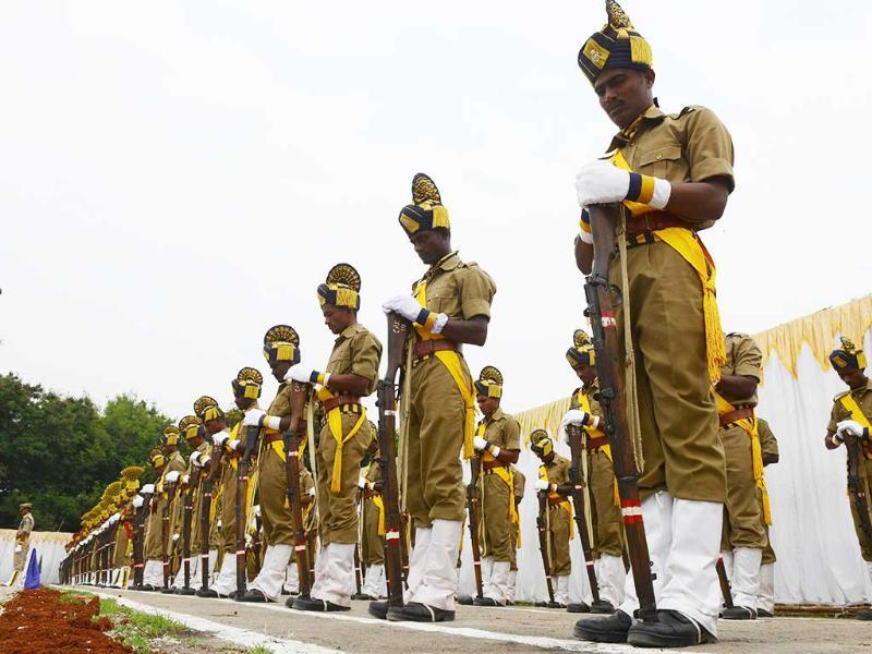 Policemen pay homage during a parade to police martyrs on the occasion of National Police Commemoration Day in Hyderabad. (AFP Photo)