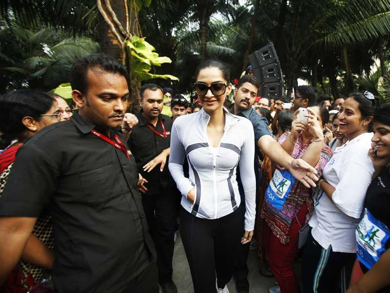 Ecstatic fans greet Sonam Kapoor with cheers, as she makes her way to the event venue. (AP Photo)