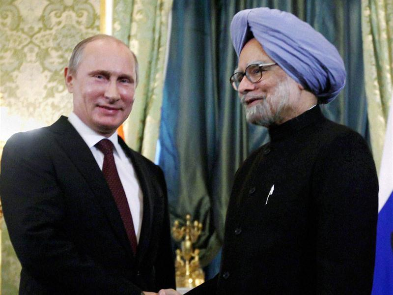 Prime Minister Manmohan Singh and Russian President Vladimir Putin shake hands at a meeting in Moscow. (PTI Photo)