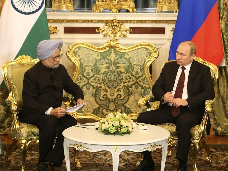 Russian President Vladimir Putin (R) speaks with Prime Minister Manmohan Singh during their meeting in Moscow. (Reuters)