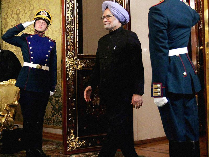 Prime Minister Manmohan Singh arrives for a meeting with Russian President Vladimir Putin in Moscow. (PTI)