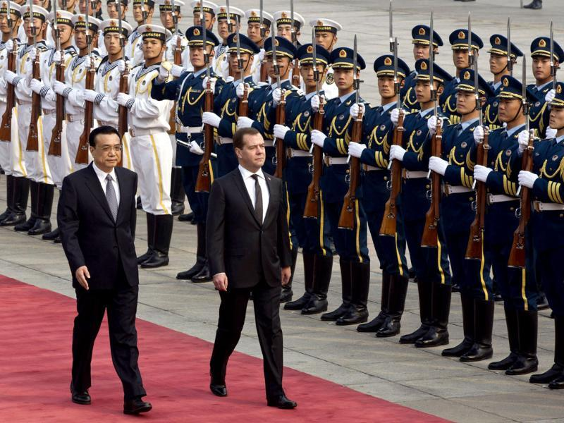 Chinese Premier Li Keqiang and Russian Prime Minister Dmitry Medvedev review an honor guard during a welcome ceremony held outside the Great Hall of the People in Beijing, China. (AP Photo)