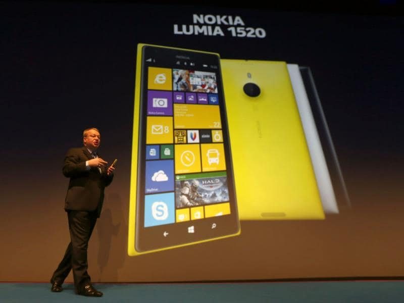 Nokia CEO, Canadian Stephen Elop, unveils the Nokia Lumia 1520 during an event in Abu Dhabi. Nokia has unveiled its first phablets -extra-large phones- and its first tablet computer. Photo: AFP / Karim Sahib
