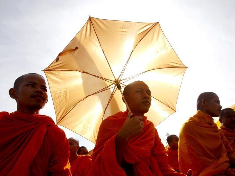 Buddhist monks, who are supporters of the opposition Cambodia National Rescue Party (CNRP), gather during a protest at the Freedom Park in central Phnom Penh. (Reuters Photo)
