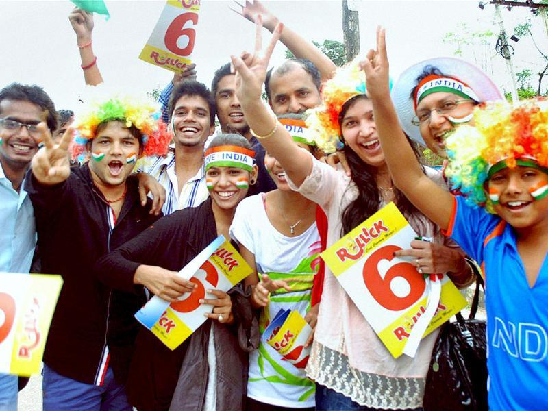 Fans celebrate as they wait to enter JSCA Stadium to watch the 4th ODI match against Australia in Ranchi. (PTI photo)