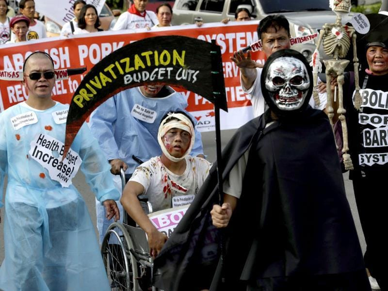 Protesters, mostly dressed in their Halloween costumes, march towards the Philippine Senate to demand the scrapping of the government funds intended for development projects. (AP Photo)