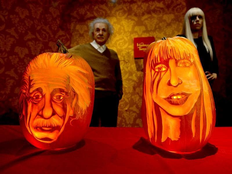 Pumpkins representing US singer Lady Gaga and scientist Albert Einstein on display in front of their wax figures at Madame Tussauds ahead of Halloween in New York. (AFP Photo)
