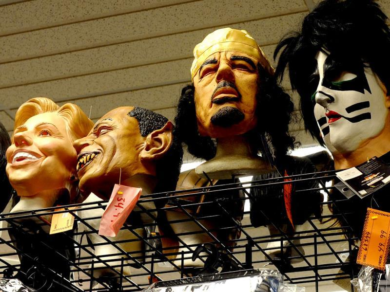 Masks displayed along with other Halloween decorations at a store in Rockville, Maryland. (AFP Photo)