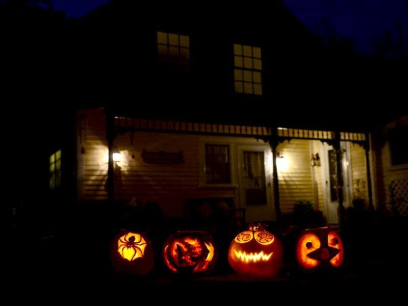Carved pumpkins lit in front of a house in Montague, Massachusetts ahead of Halloween. (AFP Photo)