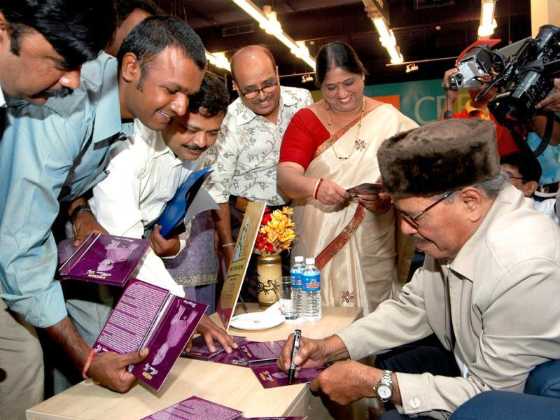 Manna Dey's magic continued to mesmerize people even years after the era of classical music was submerged in rock and pop music. In a file photo, Dey signs his DVD sets 'Manna Dey - The Ultimate Unremix' in Bangalore on March 20, 2008. (PTI Photo)