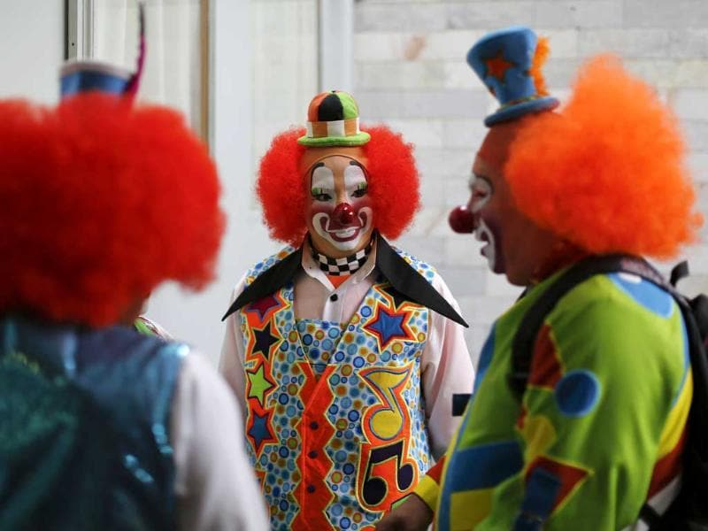 Clowns chat after registering to attend the 17th International Clown Convention in Mexico City. (AP Photo)