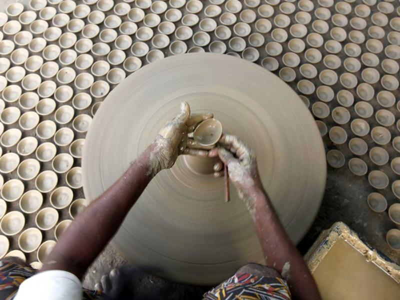 A potter makes earthen lamps for the upcoming Diwali festival in Allahabad, India. (AP Photo)
