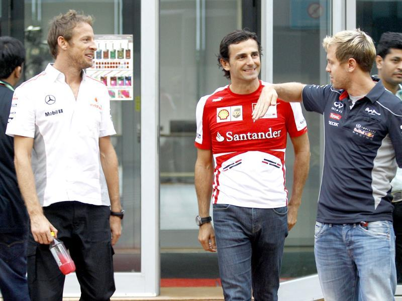 McLaren Mercedes driver Jenson Button, (L) of Britain; Ferrari reserve driver Pedro de la Rosa and Red Bull driver Sebastian Vettel (R) of Germany chat as they leave the drivers' meeting at the Indian Formula One Grand Prix at the Buddh International circuit in Greater Noida. (AP Photo)