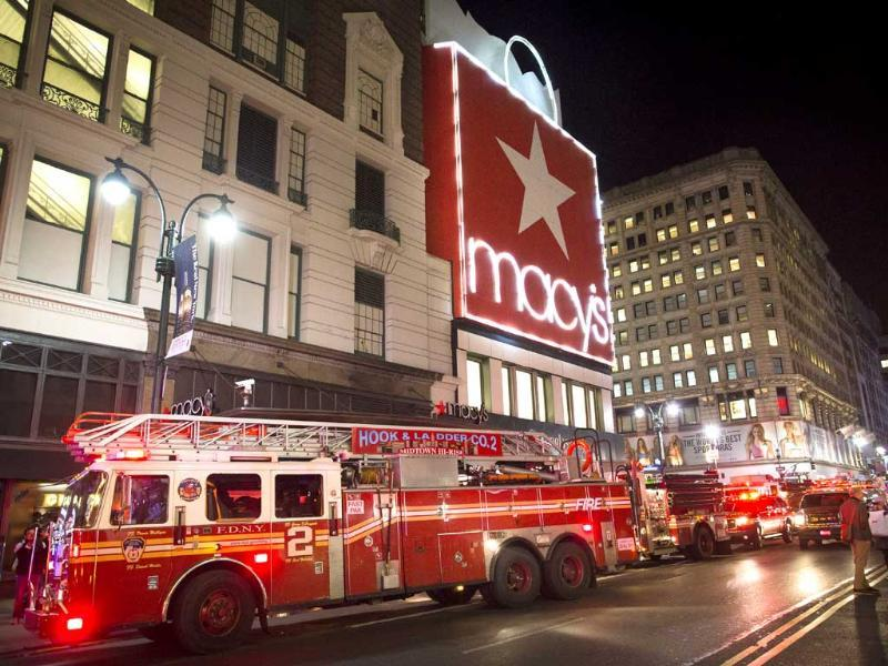 Firefighters respond to an alarm fire at the Macy's flagship Herald Square store in New York. (AP Photo)