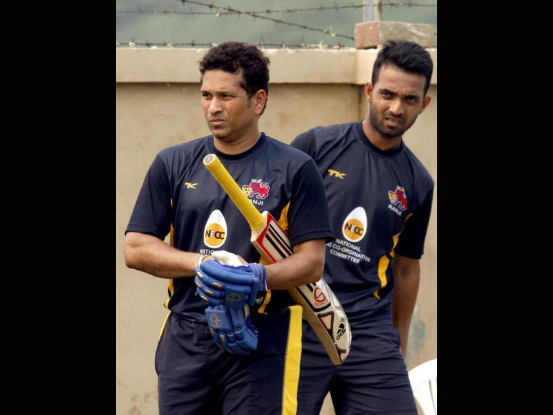 Mumbai Ranji team player Sachin Tendulkar with Ajinkya Rahane during the practice session at Bansi Lal Cricket Stadium in Lahli, Rohtak, in Haryana. (HT Photo/Sanjeev Verma)