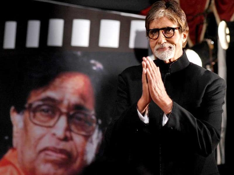 Amitabh Bachchan gestures during the 'Pandit Hridaynath Mangeshkar Awards' on the occasion of the 76th birthday celebration of Hindi and Marathi music composer and singer Pandit Hridaynath Mangeshkar and the 24th anniversary of Hridaynath Arts in Mumbai on October 26, 2013. (AFP Photo)