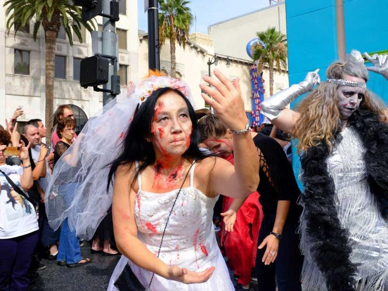 Performers dress up as zombies in LA halloween-style to celebrate the 30th anniversary of MJ's hit Thriller.